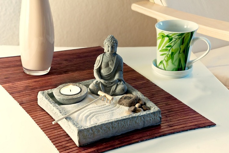 sand box with buddha statue