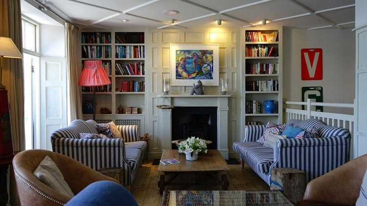 a fancy living room with a nautical appearance