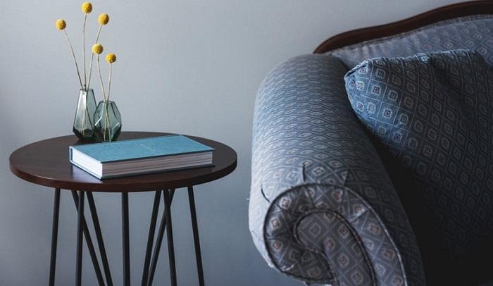a part of a blue sofa