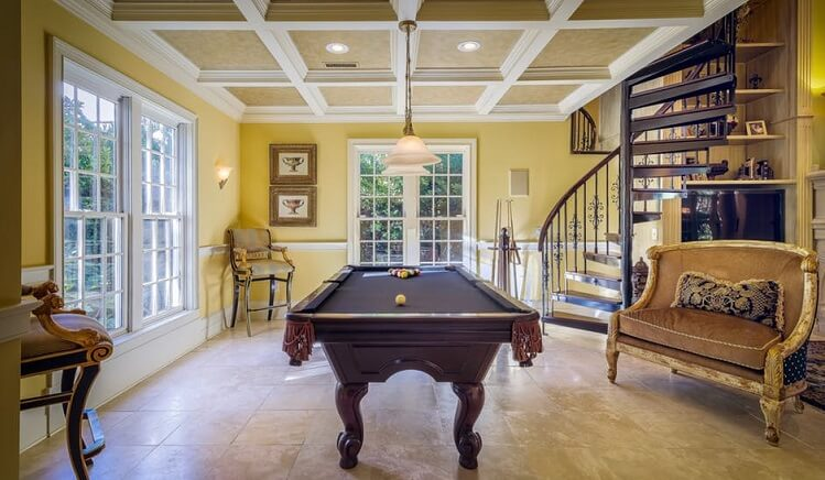 a fancy living room with a pool table