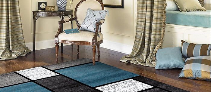 a modern blue and gray rug in a room