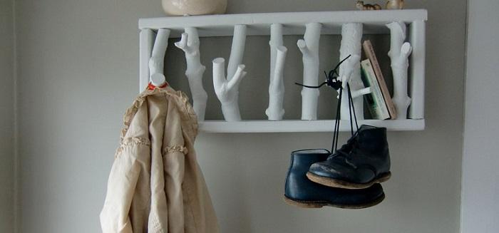 white wooden mudroom hooks
