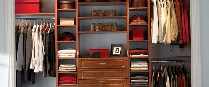 a spacious closet full of clothes