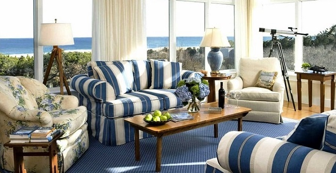 an elegant blue seaside sunroom with blue stripped furniture and blue flooring