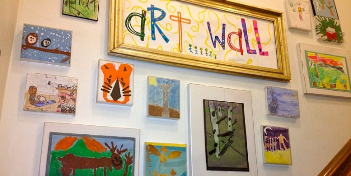 a wall full of displayed children's art