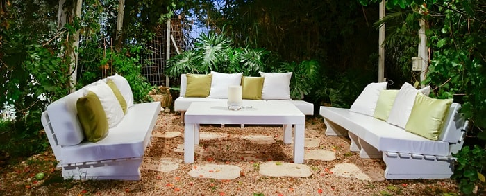 a beautiful white set of outdoor patio furniture items
