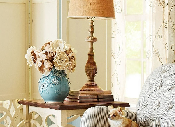 beautiful flowers in an eclectic blue vase on a table in an elegant living room