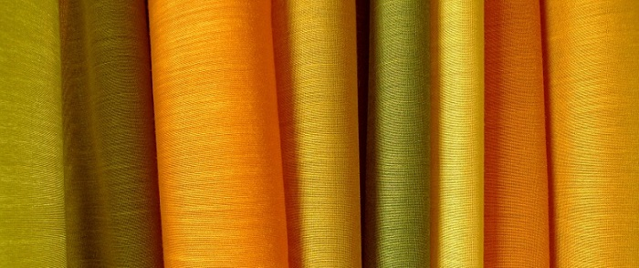 orange, green, and yellow pieces of cloth for drapes