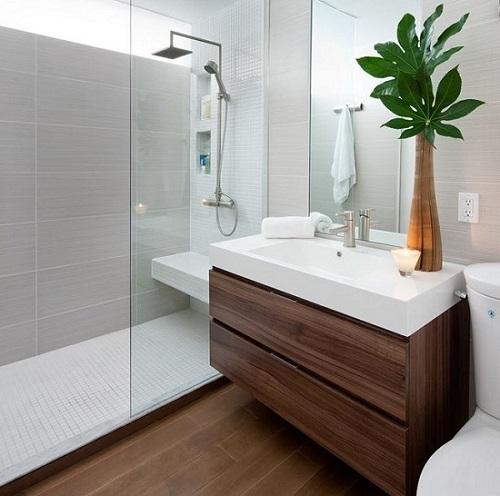 a small yet elegant bathroom with a dark brown sink furniture