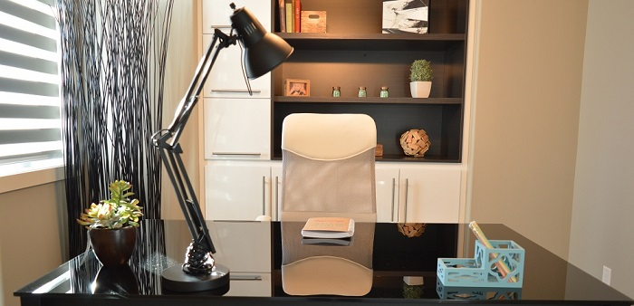 a modern monochromatic home office desk and lamp