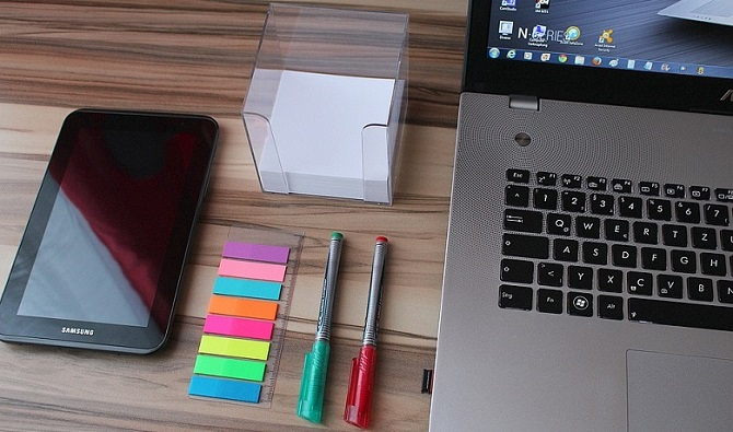 several colorful office supplies on a desk