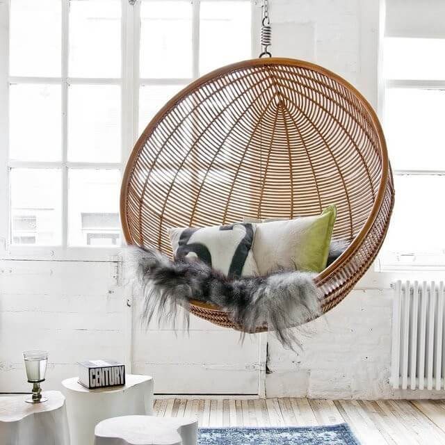 rattan hanging ball chair with fur material and pillows