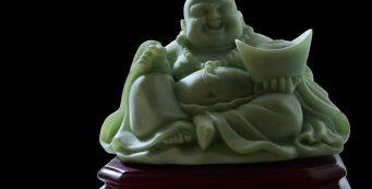 smiling buddha statue made of jade