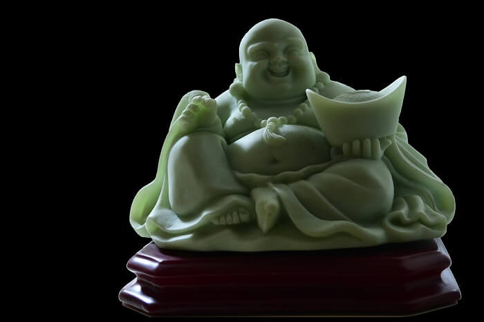 laughing buddha statue meaning and the ideal places to position it. Black Bedroom Furniture Sets. Home Design Ideas
