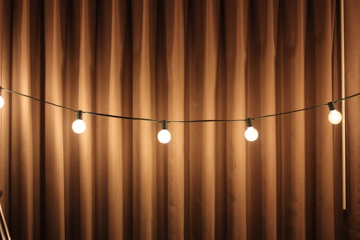 copper metallic colored curtain with string of lights