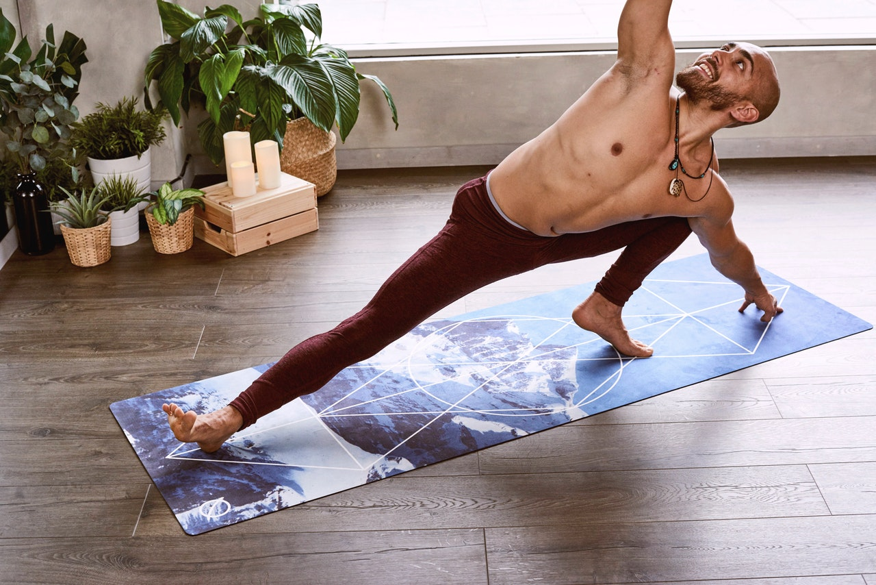 Man wearing brown pants doing yoga