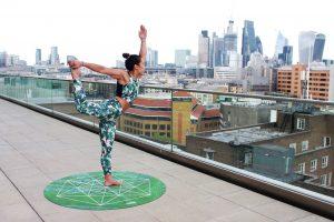 Woman on round green yoga mat